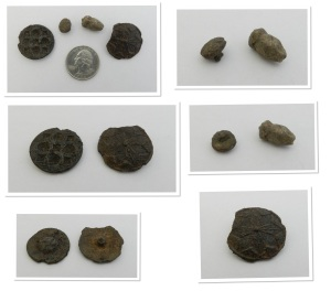 Some early buttons, and what is possibly a mount (top left picture, on left). The smallest buttons is like a doublet button, and is possibly lead. The oblong piece is a lead acorn-shaped button. The large button with a chip from the edge is a gorgeous medieval piece, with a fletched design in the center.