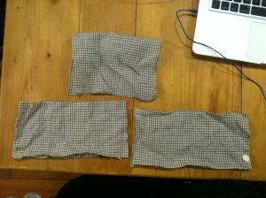 Widening a shirt collar. I took it off and cut it in half, then added a strip down the back & re-attached it.